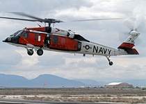 "A U.S. Navy Sikorsky MH-60S Sea Hawk helicopter (BuNo 165769) attached to the ""Longhorns"" of the Naval Station Fallon search and rescue department takes off during a higher headquarters operational assessment exercise at Naval Air Station Fallon, Nevada."