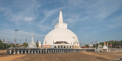 According to the Mahavamsa, the Ruwanwelisaya in Anuradhapura, Sri Lanka, was dedicated by a 30,000-strong Yona delegation from Alexandria on the Caucasus around 130 BC.
