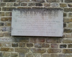"The plaque at St Edmund's Burial Ground, East Hill, Dartford. With the words ""Richard Trevithick. Approximately 25ft from this wall lie the remains of Richard Trevithick. The great engineer and pioneer of high-pressure steam. He died at the Bull Inn, Dartford and was carried here by fellow workers of Halls Engineering Works. To a paupers grave. Born Illogan, Cornwall April 13th 1771. Died Dartford, Kent April 22nd 1833""."