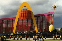 The PopMart Tour stage featured a golden arch, mirrorball lemon, and 150-foot-long LED screen. The band emerged from the lemon during encores, although it occasionally malfunctioned.
