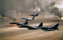 USAFE, TAC, and TAC-gained ANG F-15s and F-16s flying over the Kuwaiti desert – February 1991