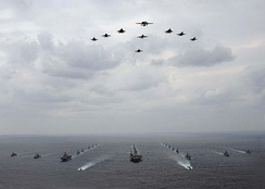 A mixed aircraft and ship formation of military vehicles during an exercise with USN and JASDF vehicles.