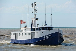Canadian commercial fishing boat coming into the harbor at Port Burwell on Lake Erie.