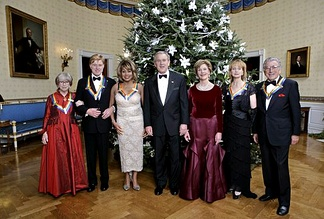 President George W. Bush and Laura Bush pose with the Kennedy Center honorees: From left to right: Julie Harris, actor Robert Redford, singer Tina Turner, ballet dancer Suzanne Farrell, and singer Tony Bennett on December 4, 2005, during the reception in the Blue Room at the White House