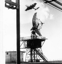 EB-57D of the 4713th DSES flying over a General Electric AN/FPS-6 radar