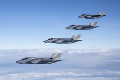A quartet of Royal Air Force F-35Bs in flight.