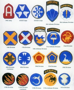 Shoulder patches were designed for units of the fictitious First United States Army Group under George Patton.