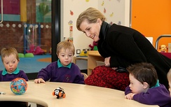 Sophie playing with children in Mencap's children centre in Belfast, 2018