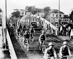 Japanese troops on bicycles advance into Saigon