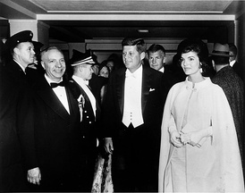 President John F. Kennedy and First Lady Jacqueline Kennedy, wearing a gown designed by Ethel Franken of Bergdorf Goodman, arrive at Sinatra's inaugural ball on the evening of Inauguration Day.