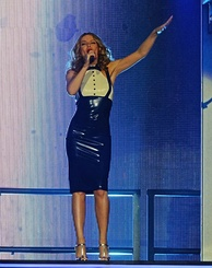 Minogue performing in Sheffield, England as part of her Kiss Me Once Tour