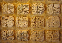 Maya glyphs in stucco at the Museo de sitio in Palenque, Mexico