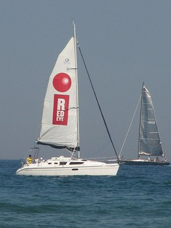 The RedEye newspaper advertised to its target market at North Avenue Beach with a sailboat billboard on Lake Michigan.