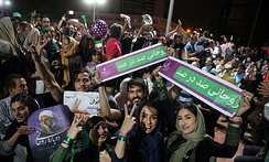 Rouhani's supporters celebrate his presidential victory on the streets of Tehran