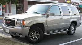 GMT400 GMC Yukon Denali (left), showing similarities to the Escalade (right).
