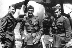Aces Eddie Rickenbacker, Douglas Campbell, and Kenneth Marr of the 94th Aero Squadron pose next to a Nieuport 28.