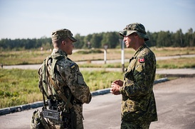 Ukrainian and Canadian soldiers converse with each other during the 2014 Rapid Trident exercise in Yavoriv, Ukraine.