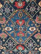 Section (central medallion) of a South Persian rug, probably Qashqai, late 19th century, showing irregular blue colours (abrash)