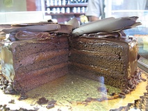 Chocolate layer cake with chocolate frosting and shaved chocolate topping