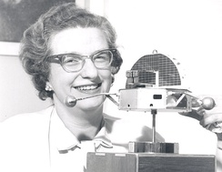Roman with a model of the Orbiting Solar Observatory in 1962.