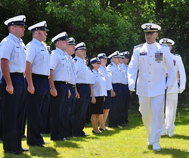 Coast Guard Station Eatons Neck commander, CWO3 Steve Pollock, reviews his crewmates during his change of command ceremony, circa June 2013