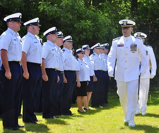 Coast Guard Station Eatons Neck commander CWO3 Steve Pollock reviews his crewmates during his change of command ceremony, c. June 2013