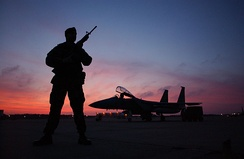 SSgt Nasam Rissvi guards an F-15 at Otis ANGB during a December sunset