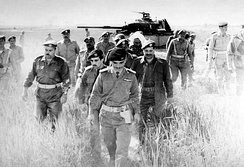 King Hussein after checking an abandoned Israeli tank in the aftermath of the Battle of Karameh, 21 March 1968.