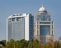 The State Administrative Building (right), behind the Wisma Innoprise (left).