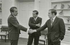 Cheney greeting President Richard Nixon in 1970 with then-Director of the Office of Economic Opportunity Donald Rumsfeld in the background.