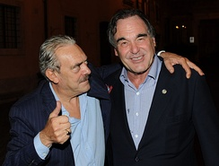 "Oliver Stone with Rino Barillari in ""Piazza dé Ricci"" exit of the restaurant ""Pierluigi"" in Rome – September 25, 2012"
