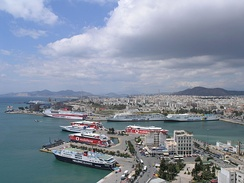 Cumulus partly spreading into stratocumulus cumulogenitus over the port of Piraeus in Greece