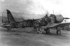 A destroyed Vindicator at Ewa field, the victim of one of the smaller attacks on the approach to Pearl Harbor