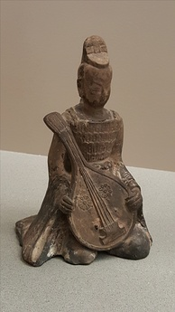 A Sui Dynasty (581–618) terracotta pipa-player in a suit of armor