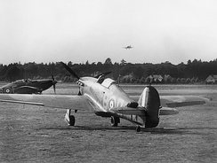 The Battle of Britain.  Hawker Hurricanes of No. 17 Squadron on the ground at Debden, while another comes in to land, July 1940.