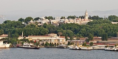 A view of Topkapı Palace from across the Golden Horn, with the Prince Islands in the background.