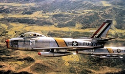 North American F-86F-25-NH Sabre, AF Ser. No. 52-5371, of the 18th Fighter-Bomber Group, 1953. Aircraft marked as Wing Commander's.