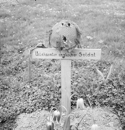 The grave of an unknown British airborne soldier at Arnhem, photographed after its liberation 15 April 1945.