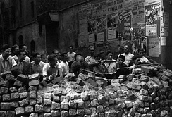 Anarchists in Barcelona, Spain. The civil war was fought between the anarchist territories, stateless lands that achieved workers' self-management, and capitalist areas of Spain controlled by the autocratic Nationalist faction