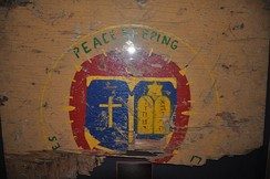 "Sign from the ""Peacekeeping Chapel"" at the Marine Barracks, on display at the Armed Forces Chaplaincy Center, Fort Jackson."