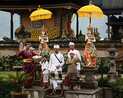 A Balinese Hindu family after puja at Bratan temple in Bali, Indonesia.