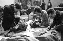 Jews clean and repair coats salvaged at Chełmno for redistribution among Volksdeutsche in accordance with the top secret August Frank memorandum. The Yellow badge was removed.[34]