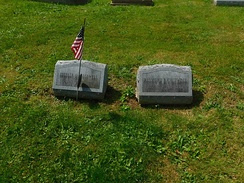 Caldwell's grave in Randolph, New York with his wife's on the left in August 2017