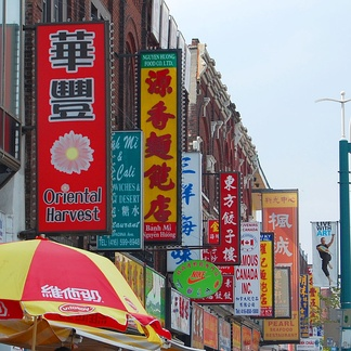 Signs in Toronto's Chinatown, one of a large collection of neighbourhoods in Canada featuring businesses that are run by, and often cater to, recent immigrants.