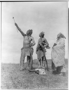 The Oath Apsaroke by Edward S. Curtis depicting Crow men giving a symbolic oath with a bison meat offering on an arrow