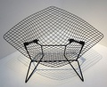 Knoll had Bertoia translate his sculptural work into furniture, resulting in his wire chairs.