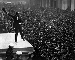 Fairbanks speaking in front of a crowd at a 1918 war bond drive in New York City