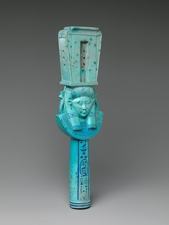 Faience sistrum with head of Hathor with bovine ears from the reign of Ptolemy I.[33] Color is intermediate between traditional Egyptian color to colors more characteristic of Ptolemaic-era faience.[34]