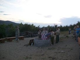 Boy Scouts retiring an American flag at a scout campout