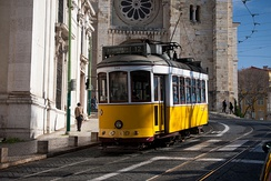 A Lisbon tram by Lisbon Cathedral and Santo António Church.